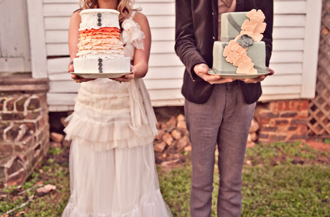 couple holding wedding cakes