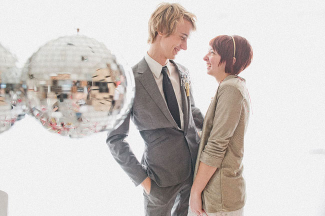 couple laughing, disco ball