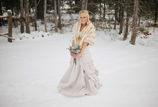 bride in fur wrap, snow
