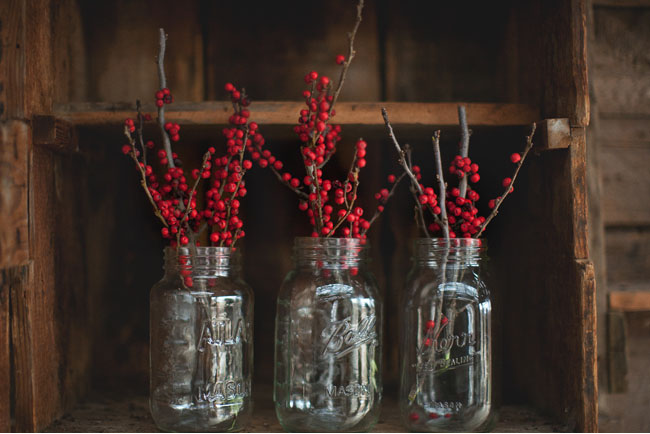 red berries in mason jars