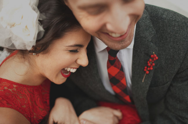 groom in red plaid tie