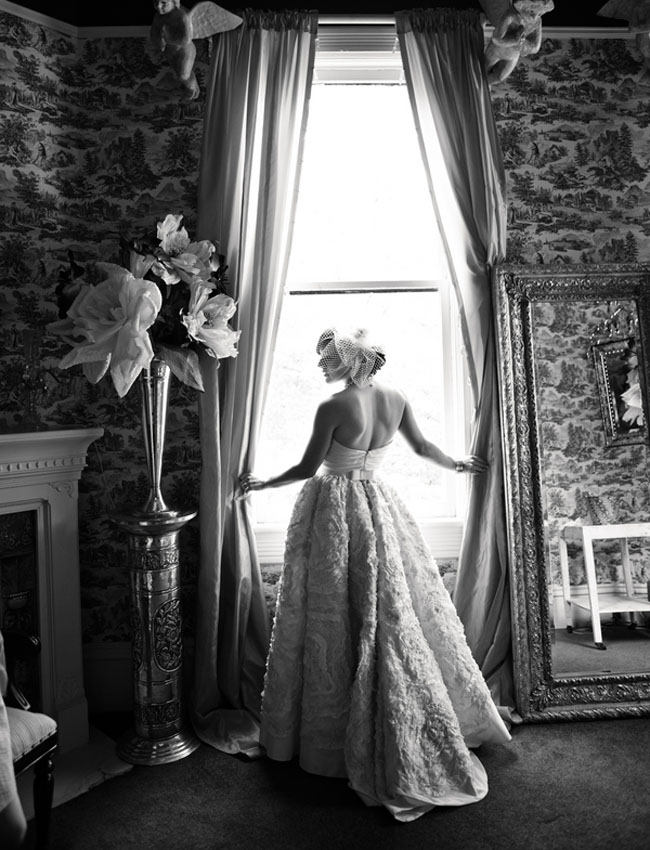 black and white photo of bride in wedding gown