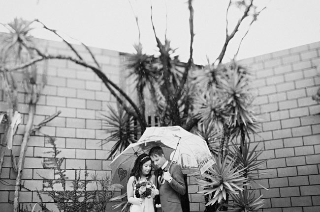 bride and groom, umbrellas