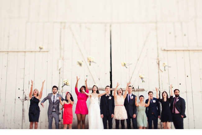 bridal party bouquet tossing in air