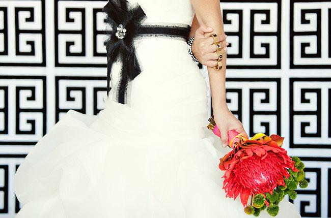 black wedding dress sash, red bouquet