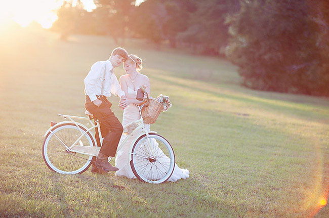 bride and groom on beach cruiser