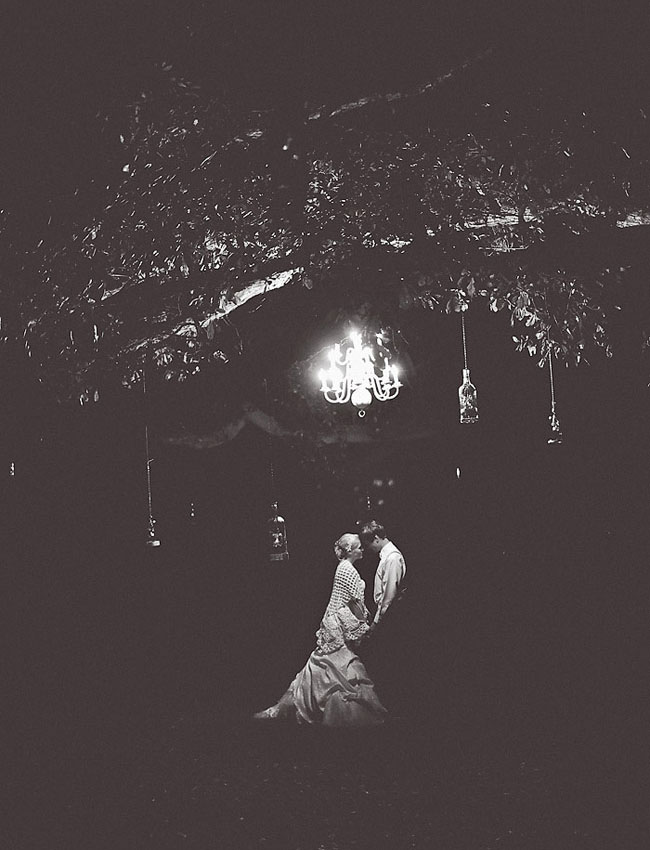 low light chandelier bride and groom