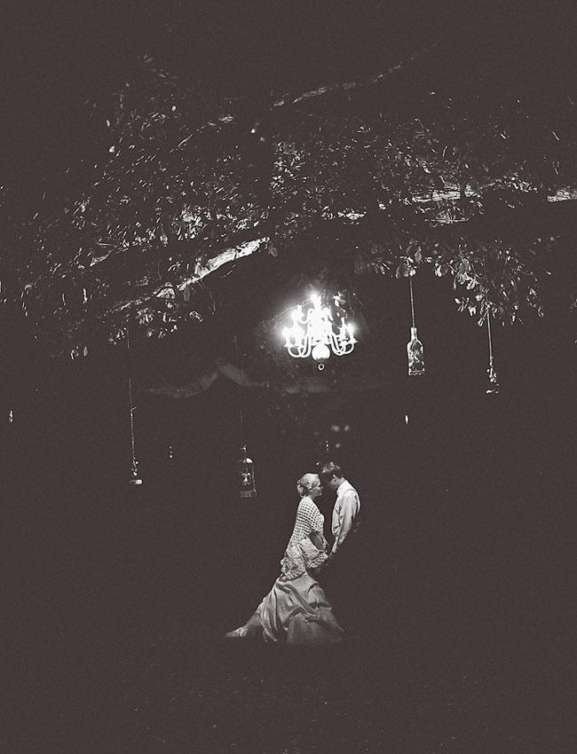 low light chandelier bride and groom