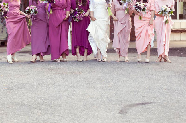 bridesmaids wearing shades of pink