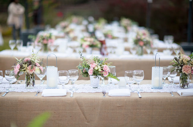 pink centerpieces, burlap tablecloth