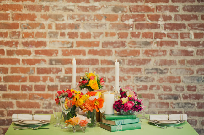 table with books and orange flowers