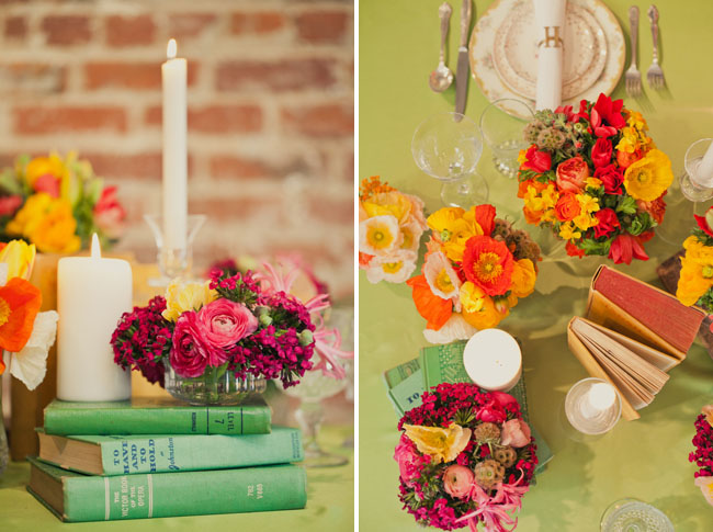table with books and orange flowers and poppies