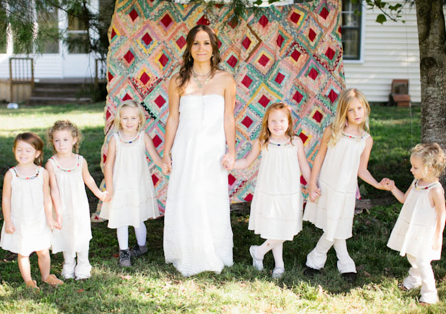 bride with lots flower girls