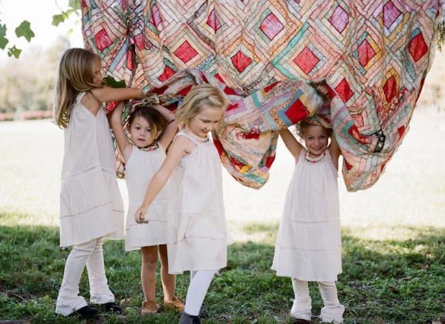 flower girls with patchwork blanket