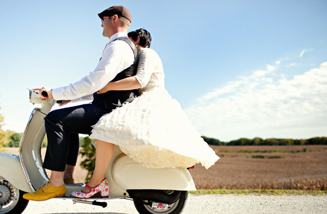 bride and groom on a vespa