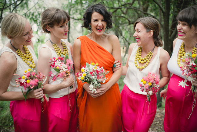 bridesmaids in neon pink and yellow