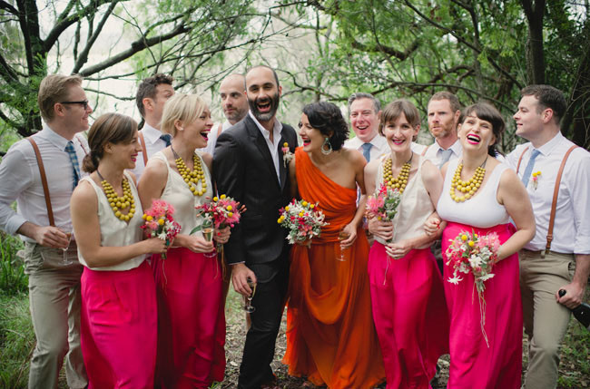 bridal party in orange and pink