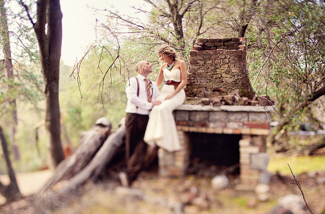 bride and groom by old fireplace