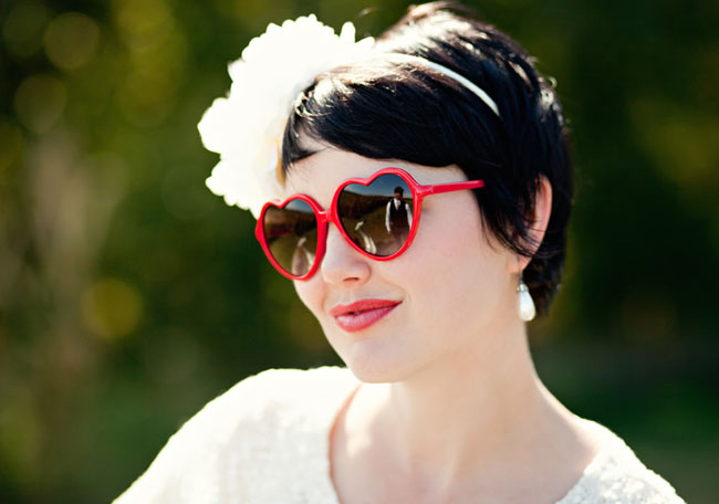 bride wearing heart sunglasses