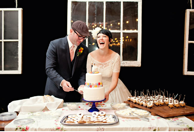 dessert bar, bride and groom cutting cake