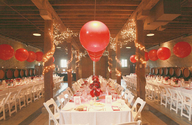 giant red balloons on tables