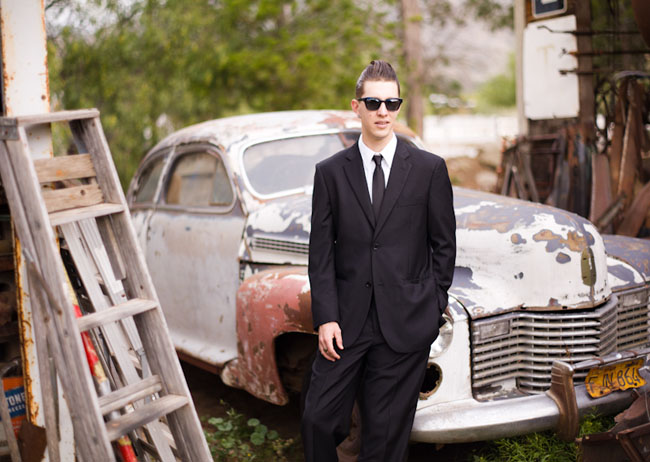 groom in front of old car