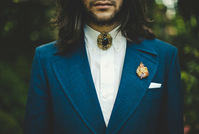 blue grooms suit with bolo