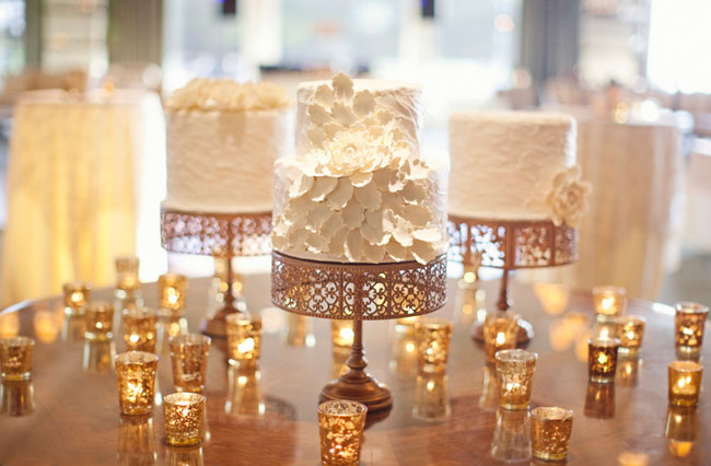 white cakes on gold stands