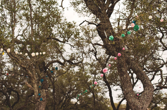 hanging pom poms in trees