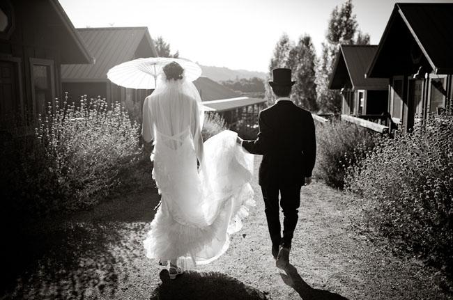 bride holding parisol