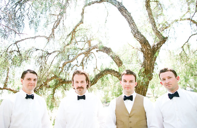 groomsmen wearing black bow ties