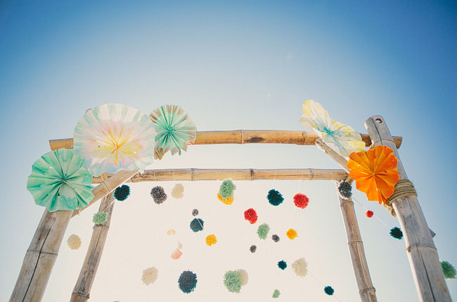 florida beach wedding pinwheels and pom pom arbor