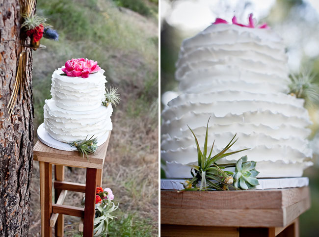 white ruffle cake with peony topper