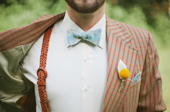 groom wearing striped suit