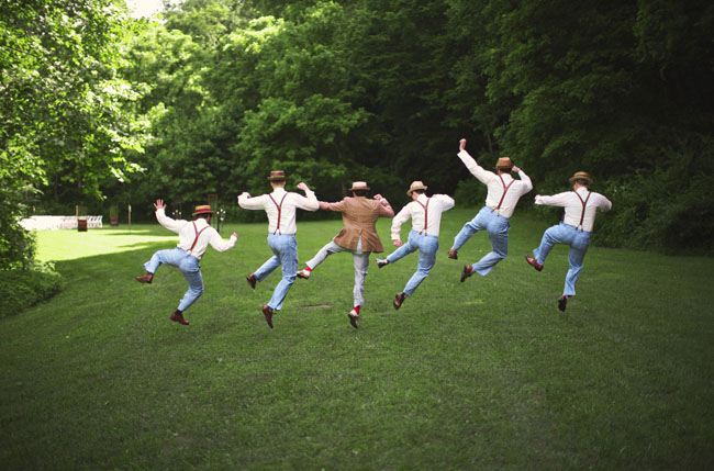 groomsmen wearing hats and suspenders
