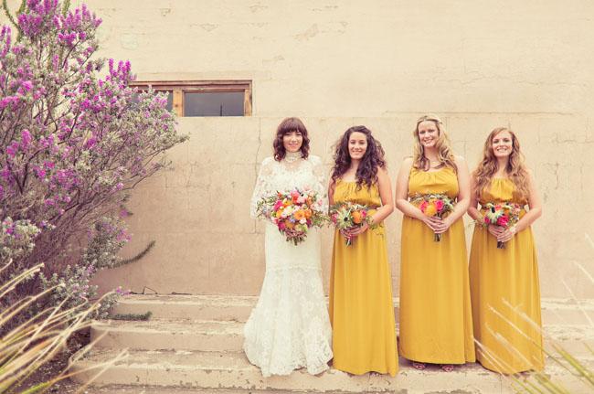 bridesmaids wearing yellow dresses