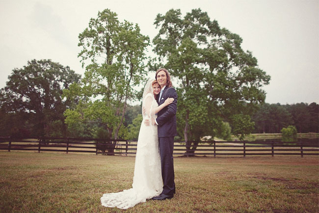 f199d516d270 bride and groom. Kelly + Colton love being outdoors so they decided to get  married under a big tree on Colton s family farm in Montgomery