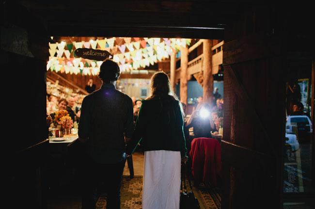 bride and groom walking into venue