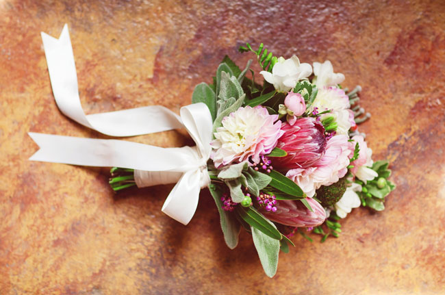 bow tied to bouquet