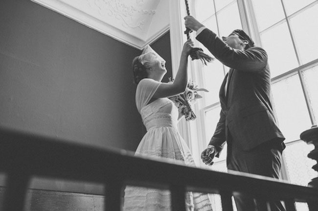bride and groom ringing church bell