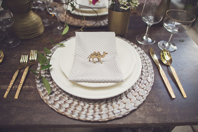 gold painted animal place setting