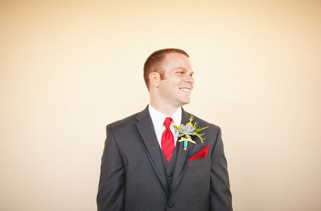groom wearing red tie
