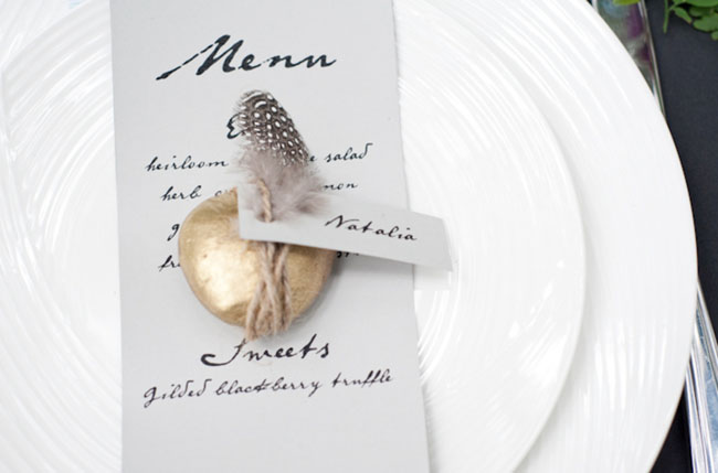 gold rock and feather place setting