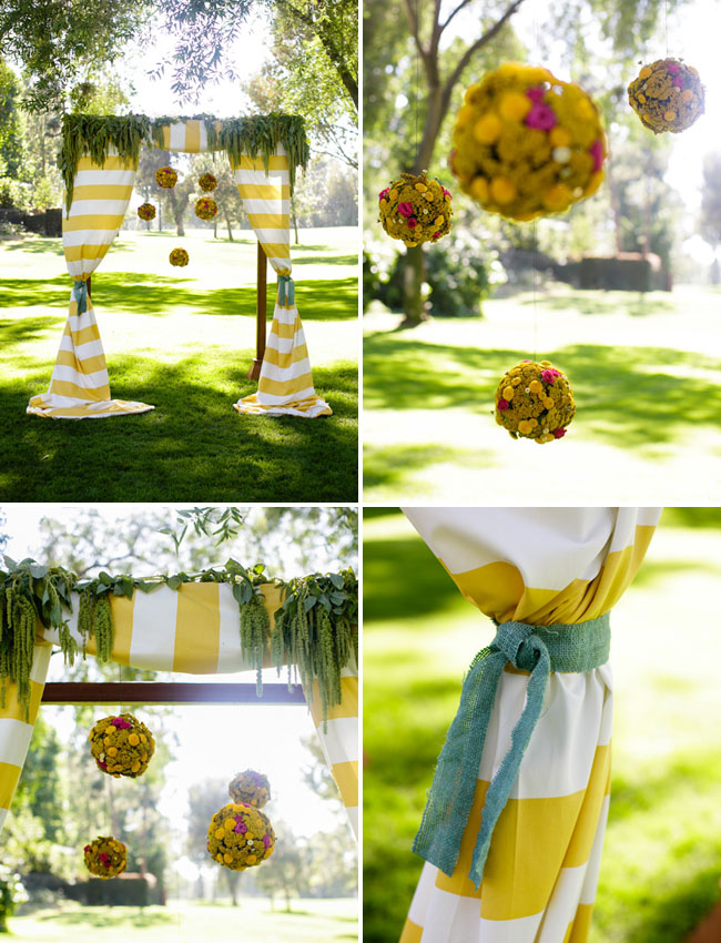 hanging flower balls, striped ceremony altar