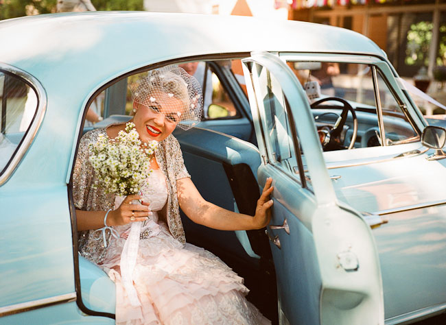bride in old car