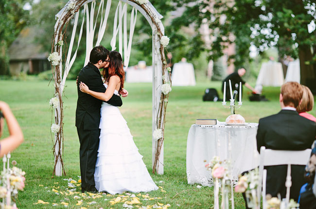 wooden arbor with ribbons