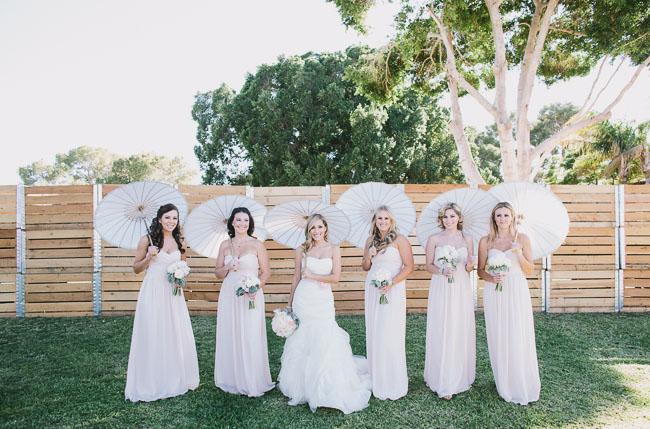 umbrellas and bridesmaids
