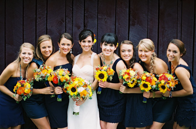 bridesmaids with sunflower bouquets