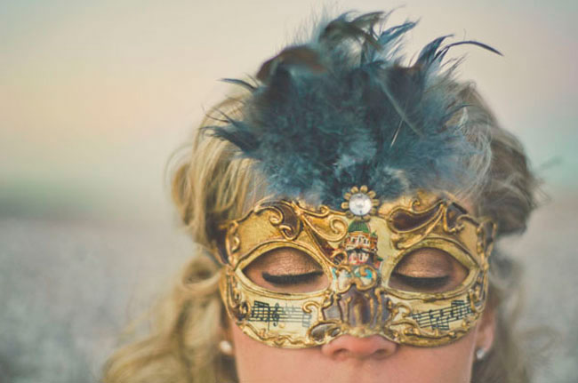 gold mask and feathers