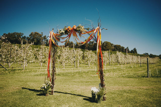 ribbon and flower ceremony arch